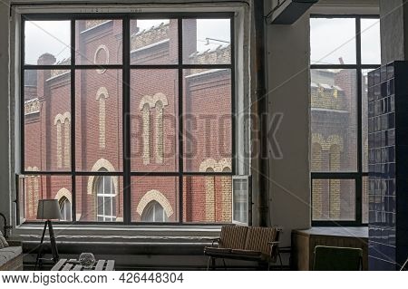 Moscow, Russia - 10 July 2021, View Through The Factory Window To The Old Electrozavod Factory