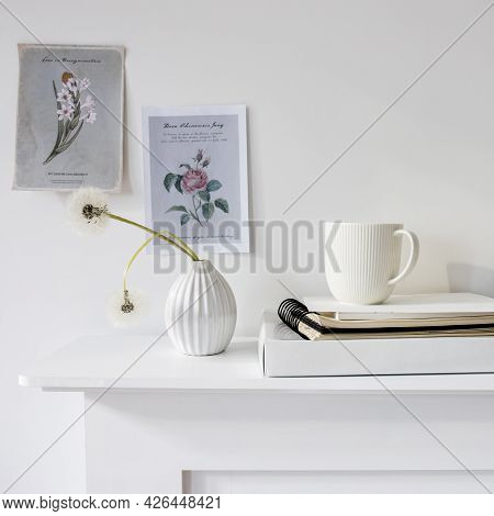 A Seventies-style Fluted Vase With Two Fluffy Dandelions Is On The Dresser. A Small Picture With A F