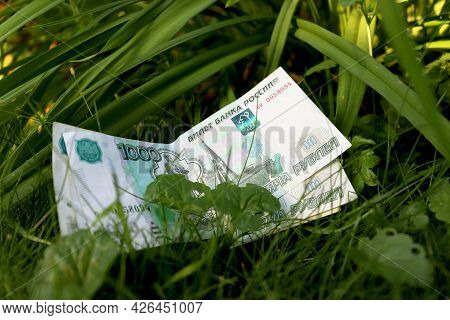 Green Money On A Green Background. Banknote One Thousand Russian Rubles. Cash Paper Money On A Backg