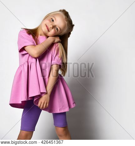 Portrait Of A Stylish Little Girl In Summer Clothes On A White Background. Studio Portrait Of A Cute