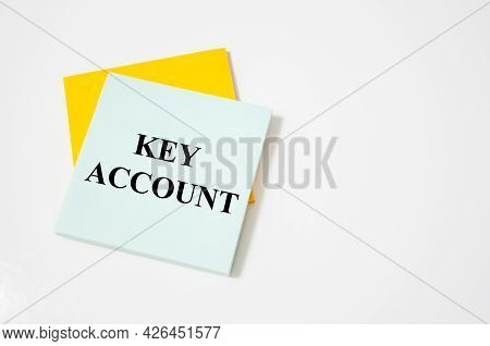 Key Account Text Written On A White Notepad With Colored Pencils And A Yellow Background