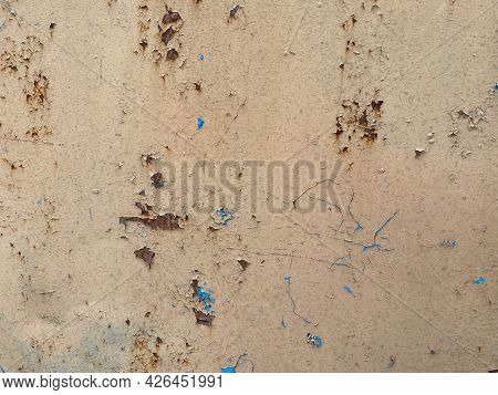 Yellow Old Scratched Sheet Of Metal, Iron Rusty Surface With Peeling Paint. The Background. Texture
