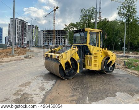 Yellow Powerful Large New Modern Road Roller For Asphalt Paving And Road Repair At Construction Site