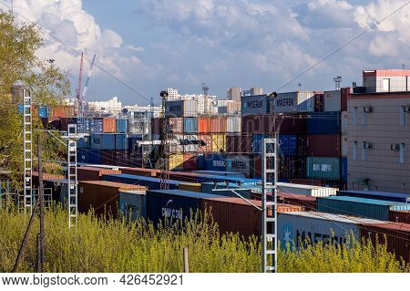 Railway Container Terminal And Logistics Center In Moscow. Freight Trains With Containers And Stacke