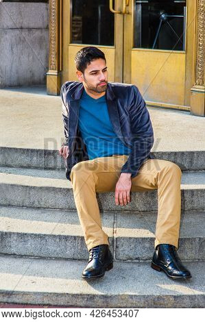 Dressing In A Dark Purple Woolen Blazer,  Dark Yellow Pants And Leather Boot Shoes, A Young Middle E