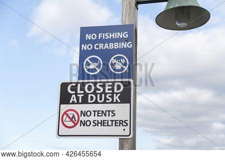 Public Signage On A Post Near The Bay Of Tacoma In Washington