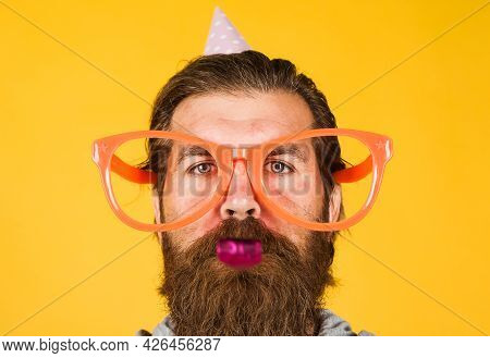 Party Time. Happy Birthday. Bearded Man In Big Glasses. Holidays And Celebration.