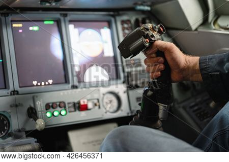 Airplane Control Stick. The Cockpit Of A Jet Aircraft. The Pilots Hand Holds The Steering Wheel.