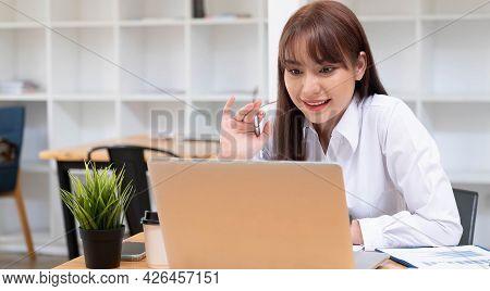 Smiling Beautiful  Woman Using Digital Tablet At Home