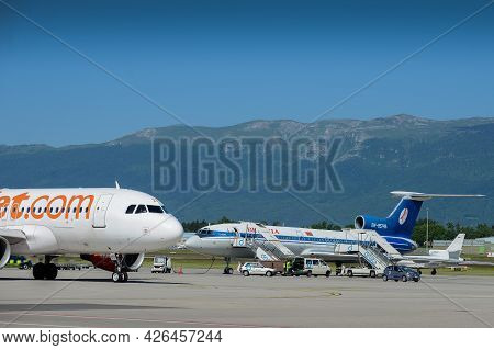 Switzerland - 05.29.2015 - Airplanes Wait For Departure Time On A Strip Against The Background Of Th