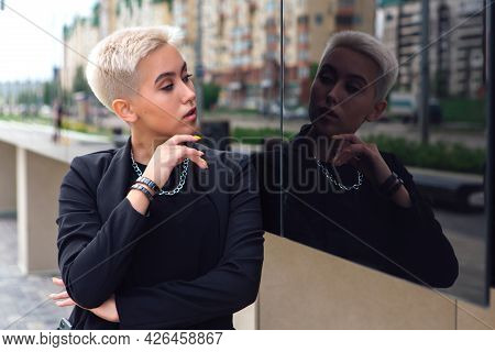 Young Stylish Business Woman With Short Hair And Nose Piercing
