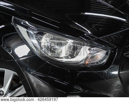 Novosibirsk, Russia - June 29, 2021: Hyundai Solaris,  Close Up Of The Car Headlights. Exterior Clos