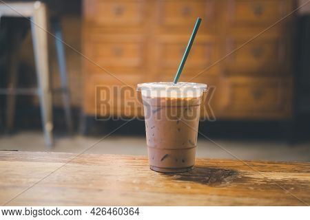 Iced Coffee Mocha On Wooden Working Space Background And Blur Background