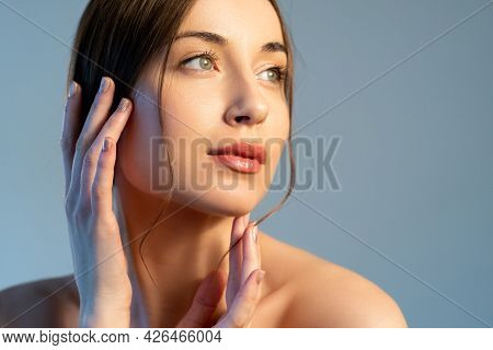 Skin Rejuvenation. Aesthetic Cosmetology. Facelift Treatment. Woman With Nude Makeup Touching Flawle
