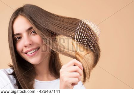 Woman Brushing Straight Natural Hair With Comb. Girl Combing Long Healthy Hair With Hairbrush. Hair