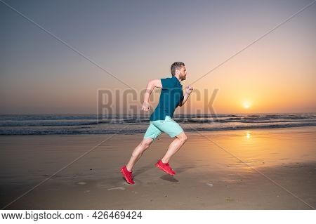 Full Length Of Healthy Man Running And Sprinting Outdoors. Male Runner. Fit Male Fitness Runner Duri