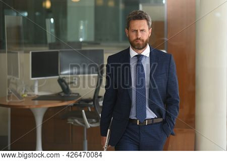 Executive Businessman. Portrait Of Ceo Near Modern Office In Suit. Happy Leader Standing In Front Of