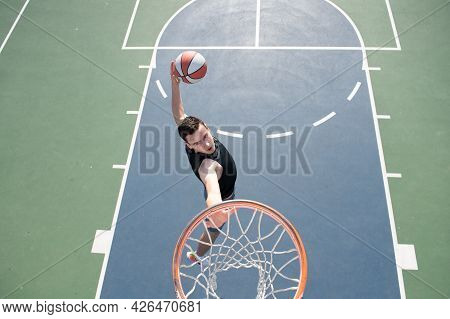 Caucasian Basketball Player Of Team In Action, Motion In Jump. Concept Of Sport, Movement, Energy An