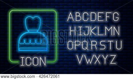 Glowing Neon Woman Dress Icon Isolated On Brick Wall Background. Clothes Sign. Neon Light Alphabet.