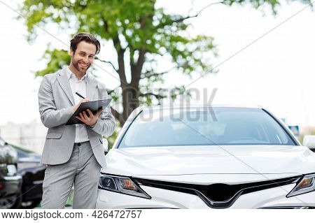 People, Car Sale, Consumerism, Auto Business, Sign Contract With Dealer In Auto Salon