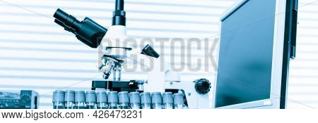 laboratory bench with microscope blood test in medical laboratory bench with microscope