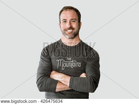 Cheerful man in a long sleeve gray top mockup