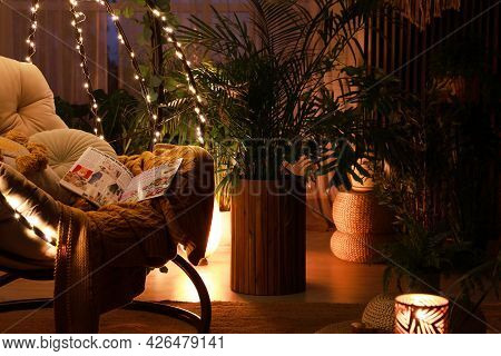 Indoor Terrace Interior With Comfortable Hanging Chair And Houseplants