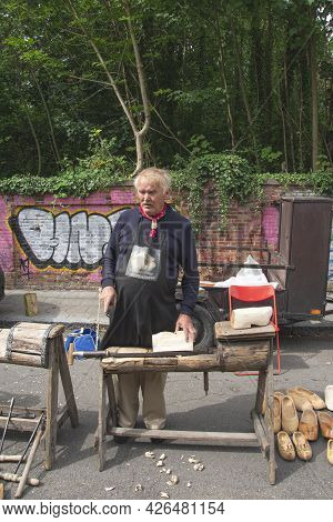 Doel, Belgium, 11 August 2019, Craftsmen, Elderly Gray Man Is A Clog Maker By Profession