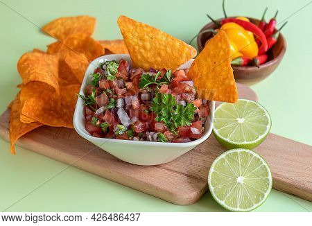 Tomato Salsa Or Salsa Roja Traditional Mexican Sauce With Ingredients For Making On A Light Green Ba