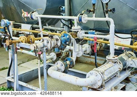 Refueling With Propane. Station To Refuel Liquefied Gas In The Tanks Of The Car. Equipment Of Gas Fi
