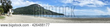 The Panorama Wide Natural Photography Beach Photo With Lifeguide Station, Tree, Clouds And Ocean Wat