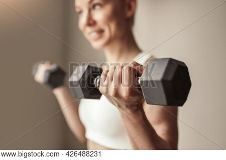 Positive Young Fit Female Doing Bicep Exercise With Heavy Dumbbells During Fitness Workout