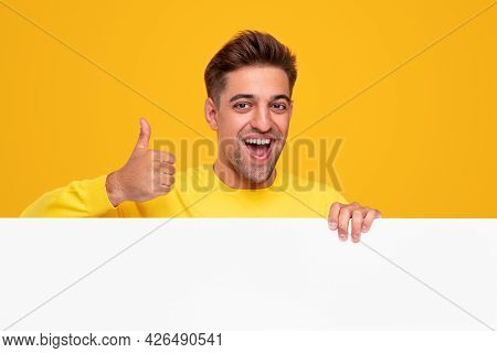 Optimistic Young Bearded Guy Smiling Happily And Showing Approving Thumb Up Gesture While Standing B