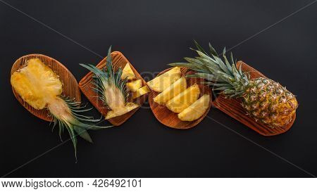 Sliced Pineapple In Different Shapes. Ripe Pineapple On Cutting Board Cooking Summer Dessert On Blac