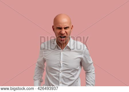 Eyes Full Of Anger. Furious Bald Man With Bristle, Having Serious Or Angry Facial Expression, Scream