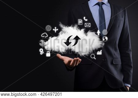 Cloud Technology. Cloud Storage Sign With Two Arrows Up And Down On Dark . Cloud Computing, Big Data