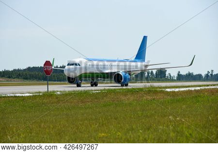 A Passenger Plane Traveling On The Runway At The Airport, Flight Ban, Stop Sign, Belarus, Minsk