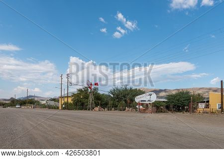 Prince Albert, South Africa - April 20, 2021: A Street Scene, With The Karooblom Restaurant And Conc
