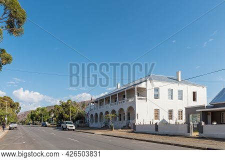 Prince Albert, South Africa - April 20, 2021: A Street Scene, With An Historic Hotel Building, In Pr