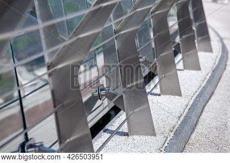 Metal Turnbuckles Fastening Of Cables With Steel Rod On Pedestrian Bridge With Stone Pebble Path And