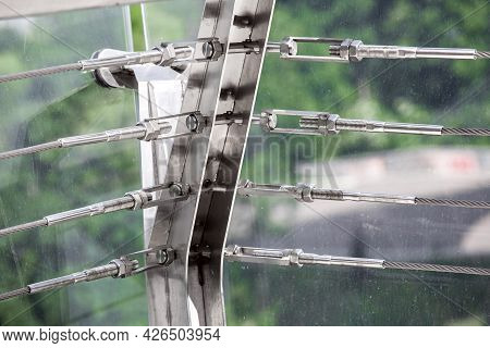 A Close Up View Of Tension Steel Cables With Steel Fasteners, A Detail Of Frame On Glass Bridge With