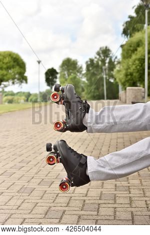Roller Skates And Legs When Falling While Skating. Accident And Crash While Rollerblading And Roller