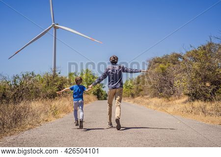 Alternative Energy, Wind Farm And Happy Time With Your Family. Happy Father On The Road With His Son