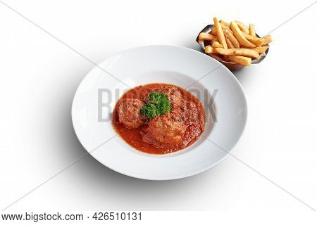 White Plate With Beef Meatballs And French Fries Isolated