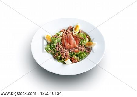 White Plate With Shrimps And Salmon On Salad Isolated