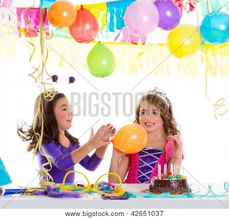 children happy birthday party girls with balloons and chocolate cake