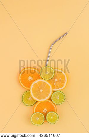 Juicy Slices Of Orange, Lemon And Lime In The Form Of A Glass, On An Orange Background. Citrus Juice