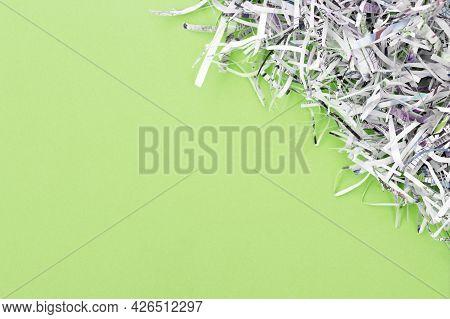The Shredded Paper On Light Green Background.
