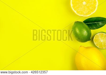 Bright Summer Citrus Flatlay With Lemons And Limes Isolated On Yellow Background.