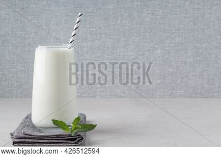 Glass Of Fresh Kefir, Yogurt Or Ayran On Grey Table, Empty Space. Natural Fermented Dairy Milk Produ